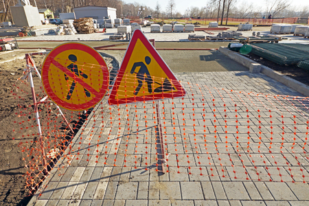 Photo for Reconstruction  of pedestrian footpath. Warning signs about road works ahead - Royalty Free Image