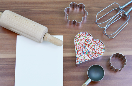 sprinkles in heart shape, equipment to make cookies and paper and pen. (Vintage)