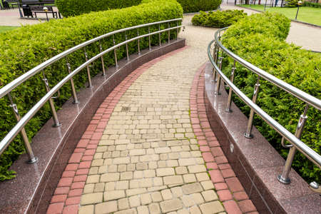 Photo for walkway with chrome steel railings in landscape design - Royalty Free Image