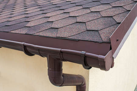 Photo for plastic drainage on the roof near the shingles - Royalty Free Image