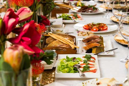 Photo pour Bread and cold snacks on the table - image libre de droit