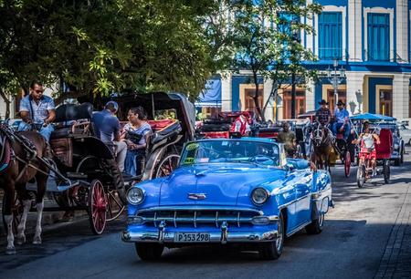 American blue convertible classic car on the street in Havana Cuba - Cuba Series Report