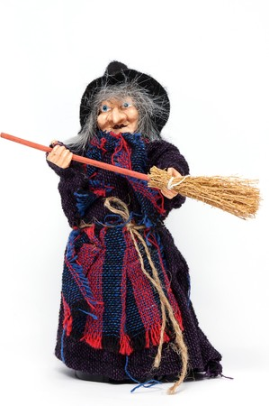 Old Halloween witch with broomstick and hat isolated on white background