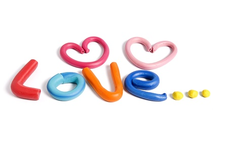 Love written with plasticine isolated on white background