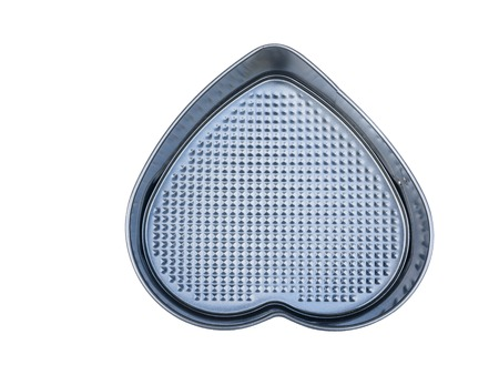 material heart-shaped baking loaf pan non-stick coating. isolated on white.