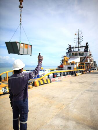 Harbor worker - watching the loading operation