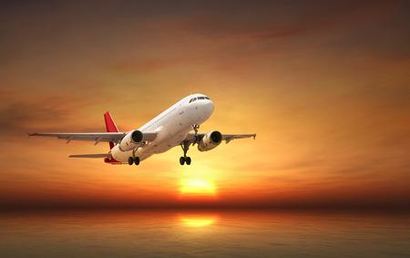 Photo pour Airplane flying above tropical sea at sunset - image libre de droit
