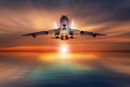 Foto de passenger plane fly up over take-off runway, concept - Imagen libre de derechos