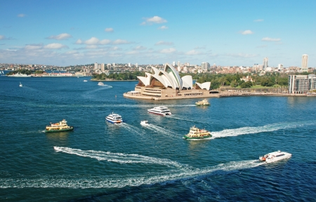 Sydney opera house with ferrys in foregournd, taken from harbor bridge