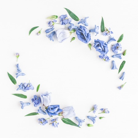 Foto de Flowers composition. Wreath made of blue flowers on white background. Flat lay, top view - Imagen libre de derechos