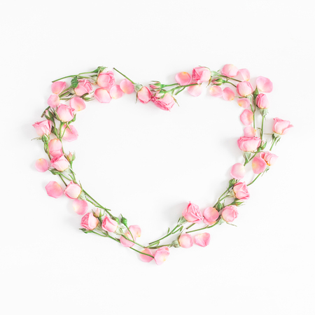 Foto de Flowers composition. Heart symbol made of pink rose flowers on white background. Flat lay, top view, copy space, square - Imagen libre de derechos