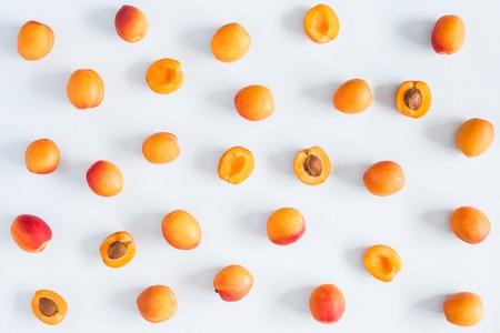 Photo pour Apricots on pastel blue background. Flat lay, top view - image libre de droit
