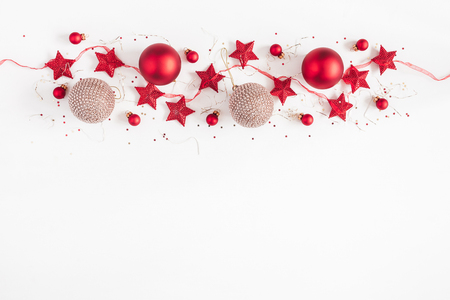 Photo for Christmas border. Christmas balls, garland, red and golden decorations on white background. Flat lay, top view, copy space - Royalty Free Image
