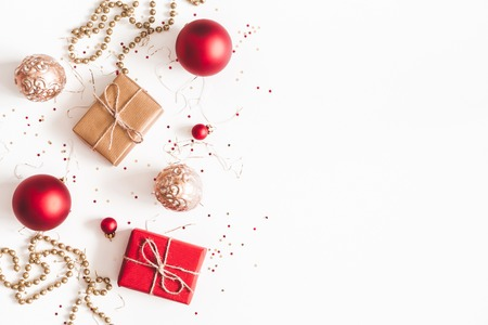 Photo pour Christmas composition. Christmas gifts, red and golden decorations on white background. Flat lay, top view, copy space - image libre de droit