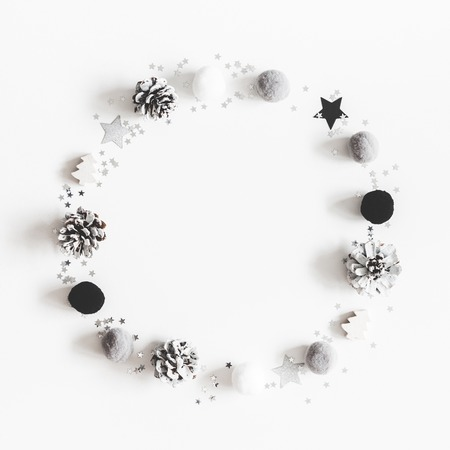 Photo for Christmas composition. Wreath made of christmas black and silver decorations on pastel gray background. Flat lay, top view, copy space, square - Royalty Free Image