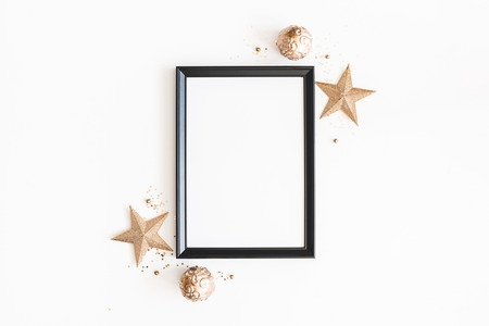 Photo pour Christmas composition. Photo frame, golden decorations on white background. Christmas, winter, new year concept. Flat lay, top view, copy space - image libre de droit