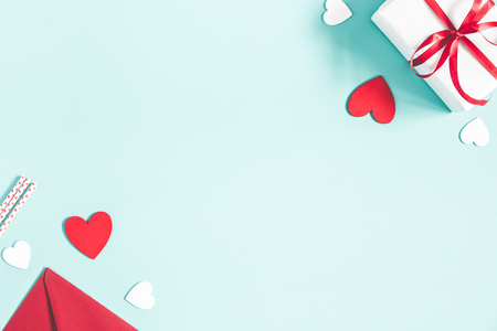 Foto de Valentine's Day background. Gifts, candle, confetti, envelope on pastel blue background. Valentines day concept. Flat lay, top view, copy space - Imagen libre de derechos