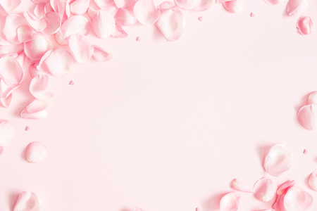 Foto per Flowers composition. Rose flower petals on pastel pink background. Valentines day, mothers day, womens day concept. Flat lay, top view, copy space - Immagine Royalty Free
