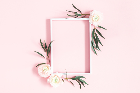Photo for Flowers composition. White flowers, eucalyptus leaves, photo frame on pastel pink background. Flat lay, top view, copy space - Royalty Free Image