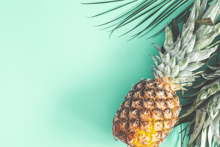 Photo for Pineapple on mint background. Summer concept. Flat lay, top view - Royalty Free Image