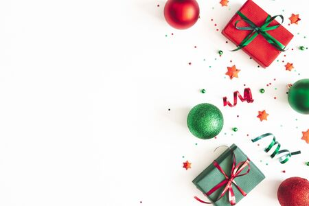 Photo pour Christmas composition. Gifts, red and green decorations on white background. Christmas, winter, new year concept. Flat lay, top view, copy space - image libre de droit