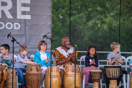 Bedford, Bedfordshire, UK. May 19,2019. Drummer and kids.Free community event in Bedford park.