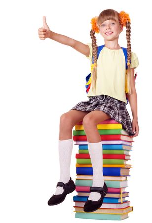 Girl sitting on pile of books showing thumb up. Isolated.