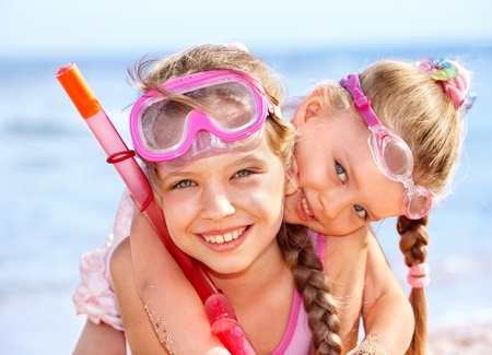 Photo for Children playing on  beach. Snorkeling. - Royalty Free Image