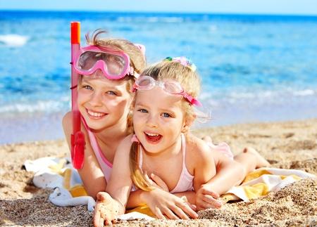 Photo pour Children playing on  beach. Snorkeling. - image libre de droit