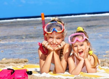 Children playing on  beach. Snorkeling.