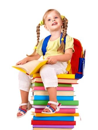 Foto de Little girl sitting on pile of books. Isolated. - Imagen libre de derechos