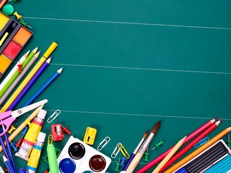 Foto de School  office supplies on board. - Imagen libre de derechos