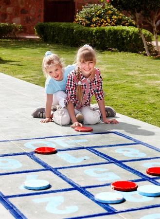 Children playing in golf. Kids outdoor games.