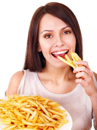 Woman eating french fries. Isolated.