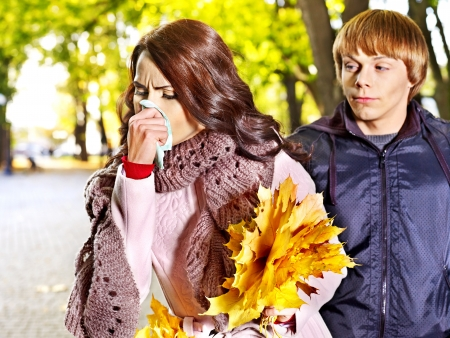 People sneezing handkerchief autumn outdoor .