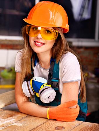 Woman in builder  respirator indoor.