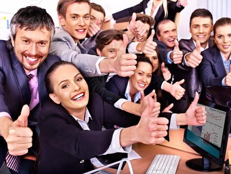 Photo pour Happy group business people thumb up  in office. - image libre de droit