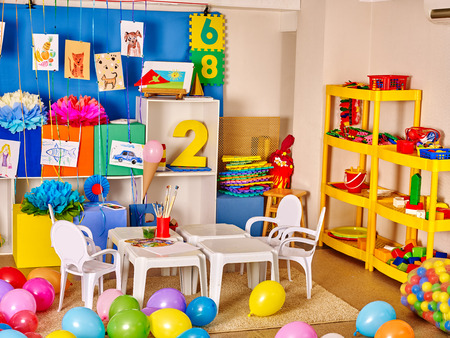 Foto de Interior of kids game room with toys in kindergarten. - Imagen libre de derechos