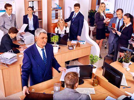 Photo pour Happy group business people in office. Old man. - image libre de droit