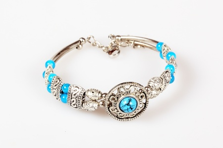 Silver bracelet with turquoise isolated over white