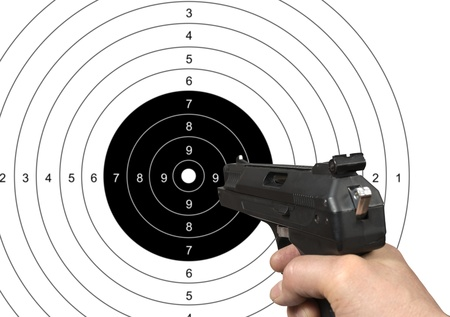 Hand holding gun shooting target with clipping path