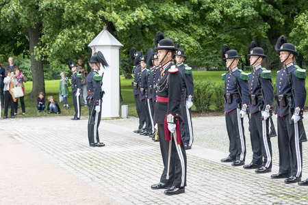 Norwegian soldiers in gala uniforms changing honor guard in front of the Royal Palace on July 1, 2016 in Oslo, Norway. This daily ceremony is a big tourist attraction.