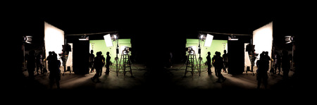 Foto per Silhouette images of video production behind the scenes or b-roll or making of TV commercial movie that film crew team lightman and cameraman working together with director in big studio with professional equipments - Immagine Royalty Free