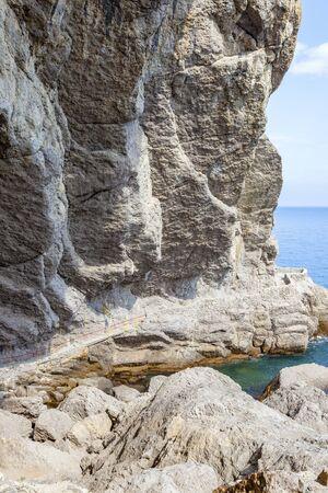 Golitsyna Trail. A narrow walking trail along the seashore along Mount Koba-Kaya. Crimea. Settlement Novyy Svet