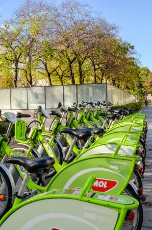 Budapest, Hungary - Nov 6, 2019: Public green bicycles for rental in the centre of the Hungarian capital city. Bike-sharing. Eco-friendly means of transport. Ecological measures in the cities. Bikes.