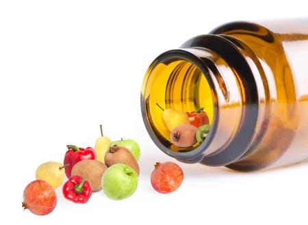 Photo pour a fruit and vegetables in bottle like vitamins, on white, macro - image libre de droit