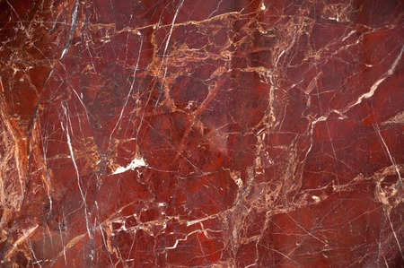 Photo for Red marble onyx texture with brown and white stripes and cracks - Royalty Free Image