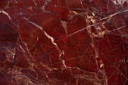 Foto de Red marble onyx texture with brown and white stripes and cracks - Imagen libre de derechos