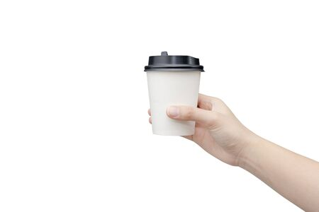 Foto de Take away coffee cup background. Female hand holding a coffee paper cup isolated on white background with clipping path. Close-up image. - Imagen libre de derechos