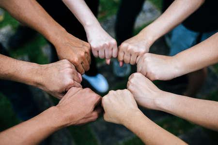 Photo pour Close up of students standing hands making fist bump gesture. - image libre de droit